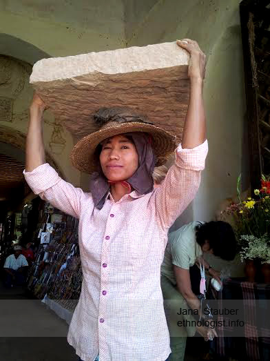 A Girl Carrying the Heavy Stone in Barma