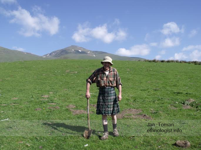 The farmer from Tombreck farm. Behind farmer is mountain of Ben Lawers. Photo: Jan Toman
